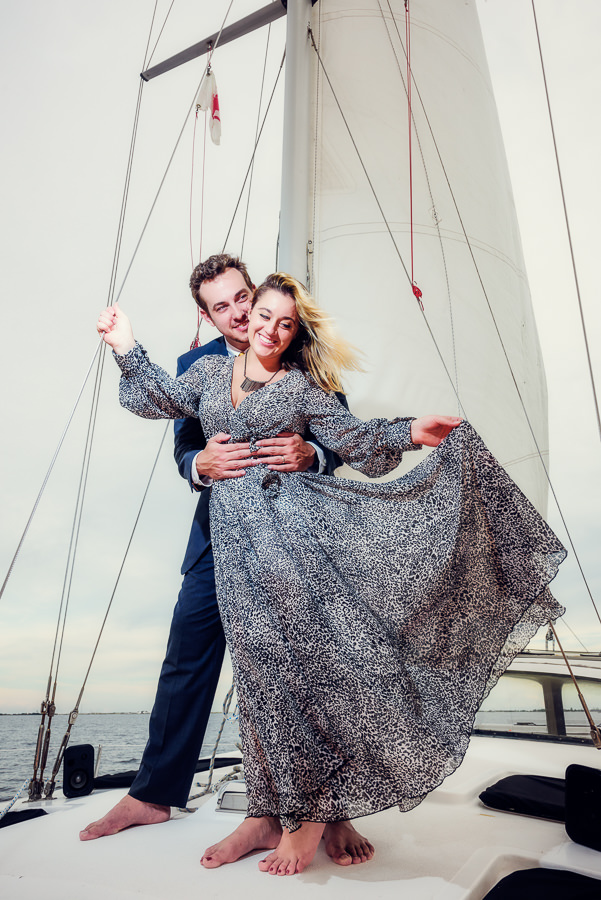 Husband holding his Wife on a sailboat, Epic Pensacola Sunset Sailing, Lazzat Photography