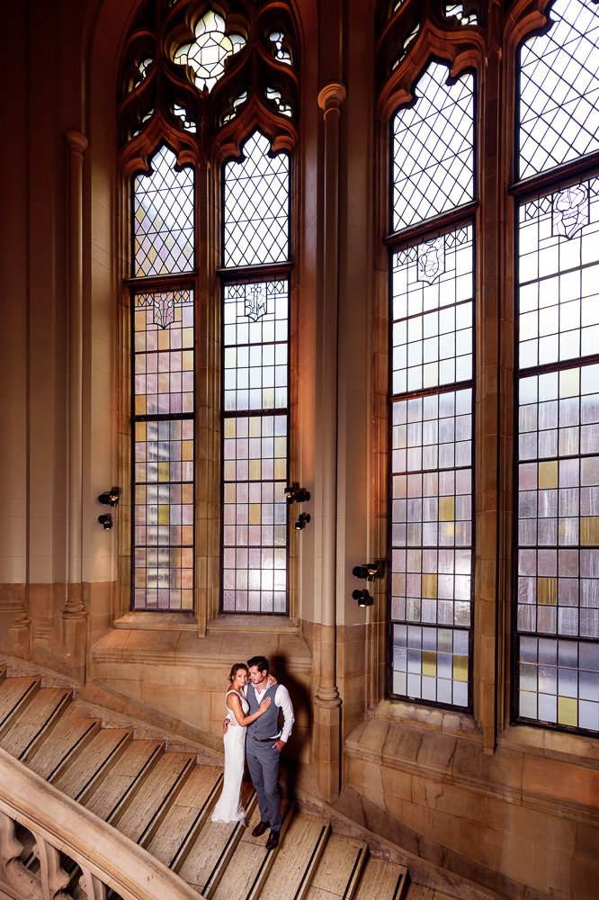Couple looking at the camera on a staircase in the Suzzallo library, Epic Couple's Session in Seattle, Lazzat Photography, Engagement photos, wedding photos