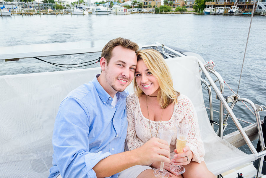 Newlyweds champagne on a sailboat, Epic Pensacola Sunset Sailing, Lazzat Photography Sunset Sailing