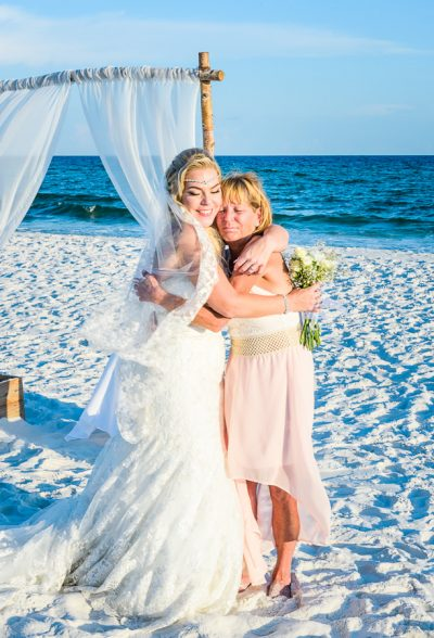 Pensacola Beach Destination Wedding, Desireé and her mom hugging on the beach, Lazzat Photography
