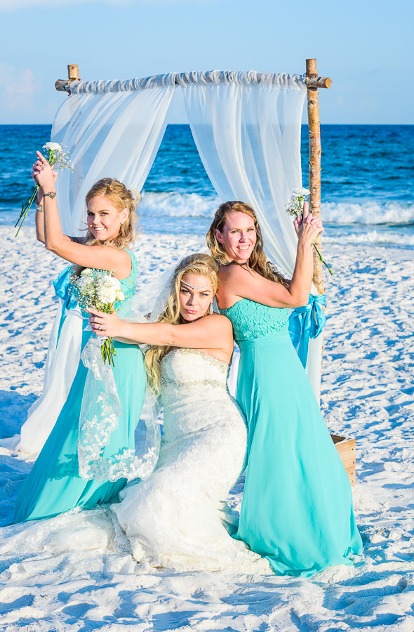 Pensacola Beach Destination Wedding, Desireé and her sister's doing Charlie's angels pose, Lazzat Photography