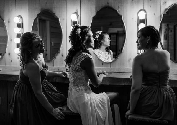 Michelle and her Bridesmaids looking at each other in front of the mirrors in the bridal suite, Ates Ranch Wedding Barn, Rustic Barn Wedding, Pensacola wedding photographer, Lazzat Photography