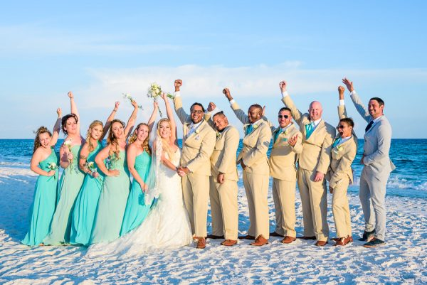 Pensacola Beach Destination Wedding, Desireé, Delaine and their wedding party cheering on the beach, Lazzat Photography