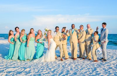 Pensacola Beach Destination Wedding, Desireé, Delaine and their wedding party silly pose on the beach, Lazzat Photography