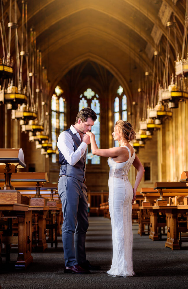 Man kissing woman's hand in the Suzzallo library, Epic Couple's Session in Seattle, Lazzat Photography, Engagement photos, wedding photos