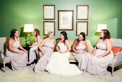 Downtown Pensacola Wedding, Kerri and her bridesmaids sitting looking at each other, Lazzat Photography