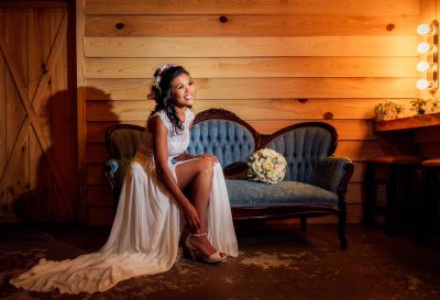 Michelle on the couch in the bridal suite full body, Ates Ranch Wedding Barn, Rustic Barn Wedding, Pensacola wedding photographer, Lazzat Photography