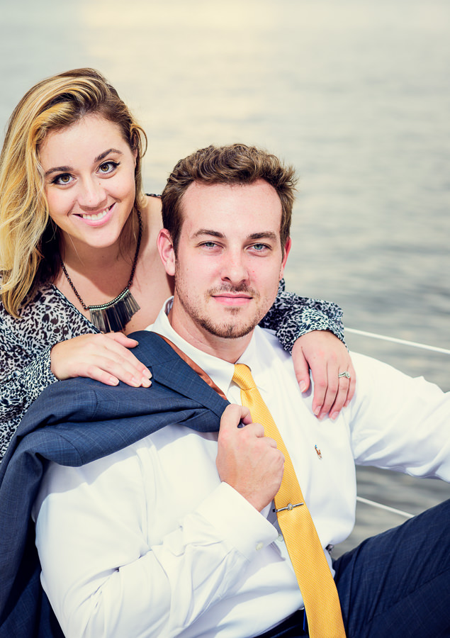 Close up of newlyweds looking at the camera on a sailboat, Epic Pensacola Sunset Sailing, Lazzat Photography