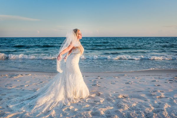 Pensacola Beach Destination Wedding, Desireé holding her veil back on the beach, Lazzat Photography