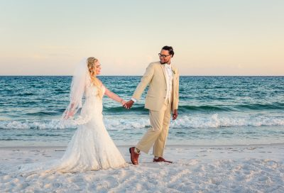 Pensacola Beach Destination Wedding, Delaine leading Desireé down the beach, Lazzat Photography