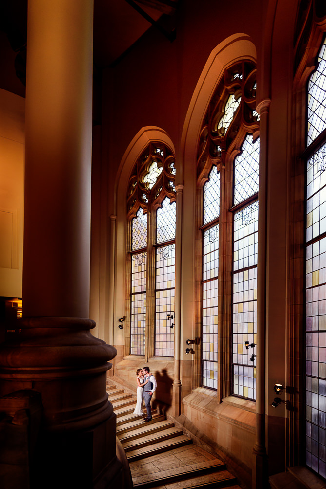 Couple looking at each other on a staircase in the Suzzallo library, Epic Couple's Session in Seattle, Lazzat Photography, Engagement photos, wedding photos