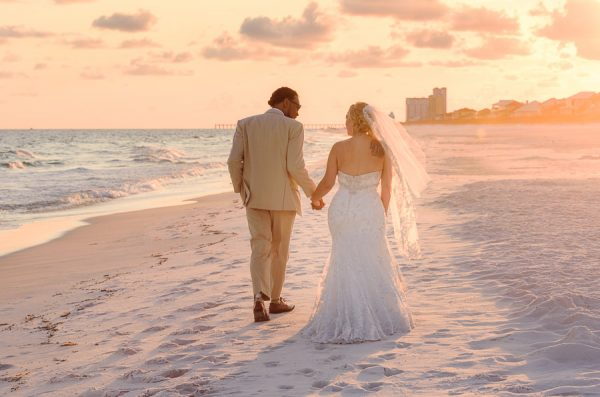 Pensacola Beach Destination Wedding, Delaine and Desireé walking down the beach, Lazzat Photography