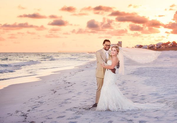Pensacola Beach Destination Wedding, Delaine and Desireé on the beach with veil flying, Lazzat Photography