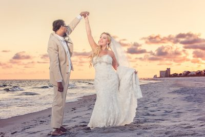 Pensacola Beach Destination Wedding, Delaine spinning Desireé on the beach, Lazzat Photography