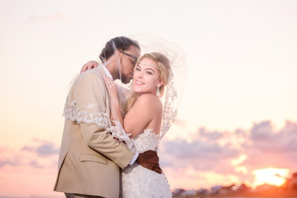 Pensacola Beach Destination Wedding, Delaine kissing Desireé on the cheek under the veil, Lazzat Photography