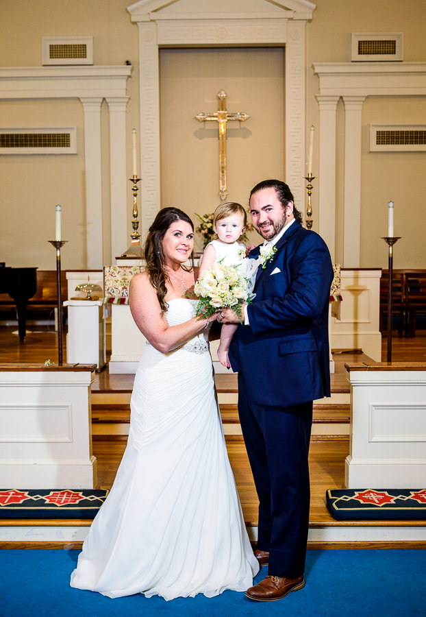 Downtown Pensacola Wedding, Cody, Kerri and baby at the alter of the church, Lazzat Photography