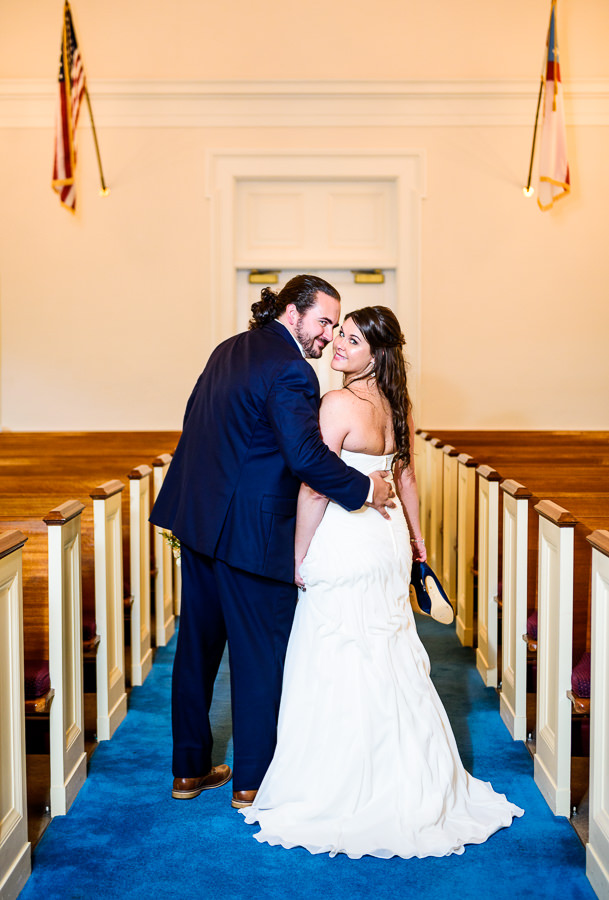 Downtown Pensacola Wedding, Cody and Kerri looking back down the aisle of the church, Lazzat Photography