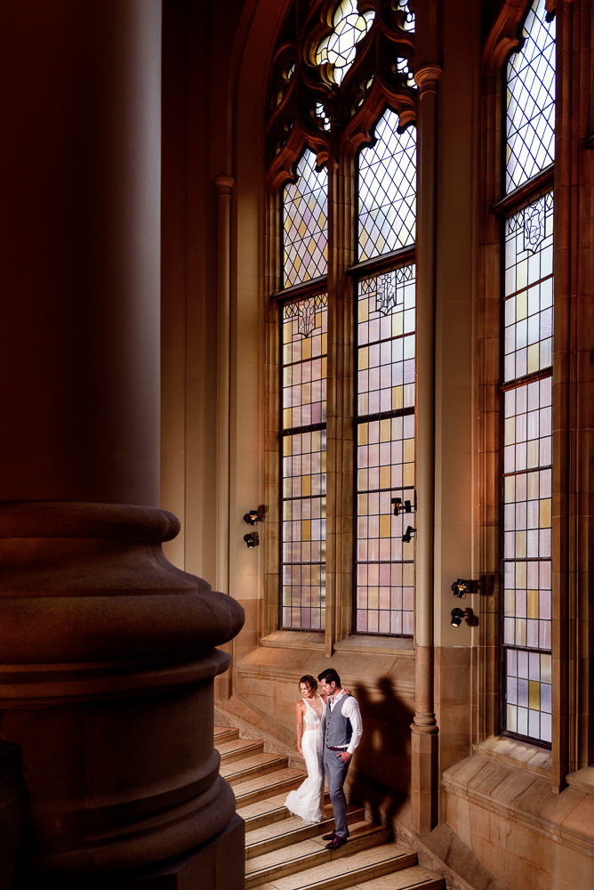 Couple looking down on a staircase in the Suzzallo library, Epic Couple's Session in Seattle, Lazzat Photography, Engagement photos, wedding photos