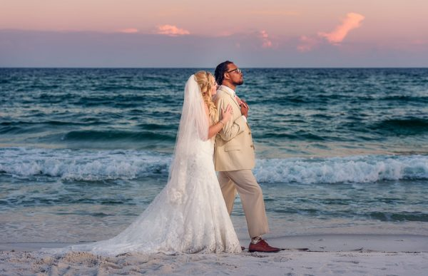 Pensacola Beach Destination Wedding, Delaine and Desireé looking off into the distance full body, Lazzat Photography