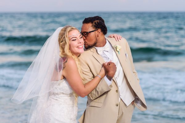 Pensacola Beach Destination Wedding, Delaine kissing Desireé's cheek, Lazzat Photography