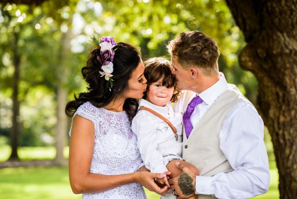 Michelle and Brent kissing their youngest son, Ates Ranch Wedding Barn, Rustic Barn Wedding, Pensacola wedding photographer, Lazzat Photography
