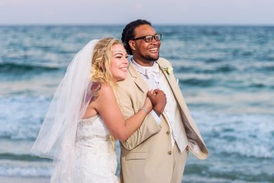 Pensacola Beach Destination Wedding, Delaine and Desireé looking off into the distance close up, Lazzat Photography