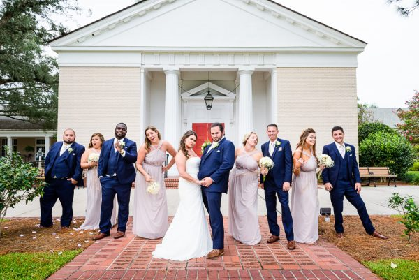 Downtown Pensacola Wedding, Cody and Kerri and wedding party with funny faces in front of church, Lazzat Photography