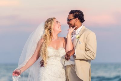 Pensacola Beach Destination Wedding, Delaine and Desireé looking at each other while she touches his chin, Lazzat Photography