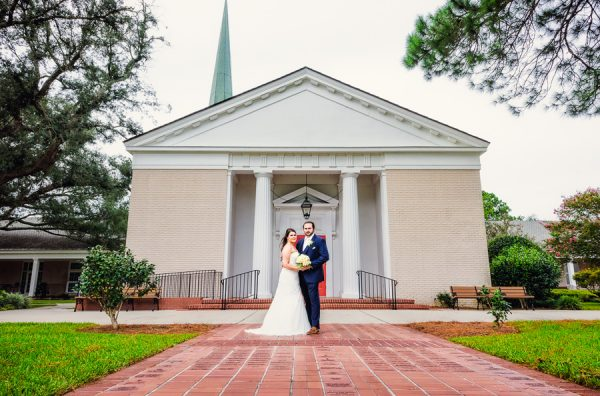 Downtown Pensacola Wedding, Cody and Kerri looking at camera in front of the church, Lazzat Photography