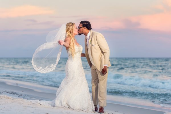 Pensacola Beach Destination Wedding, Delaine and Desireé kissing on the beach, Lazzat Photography