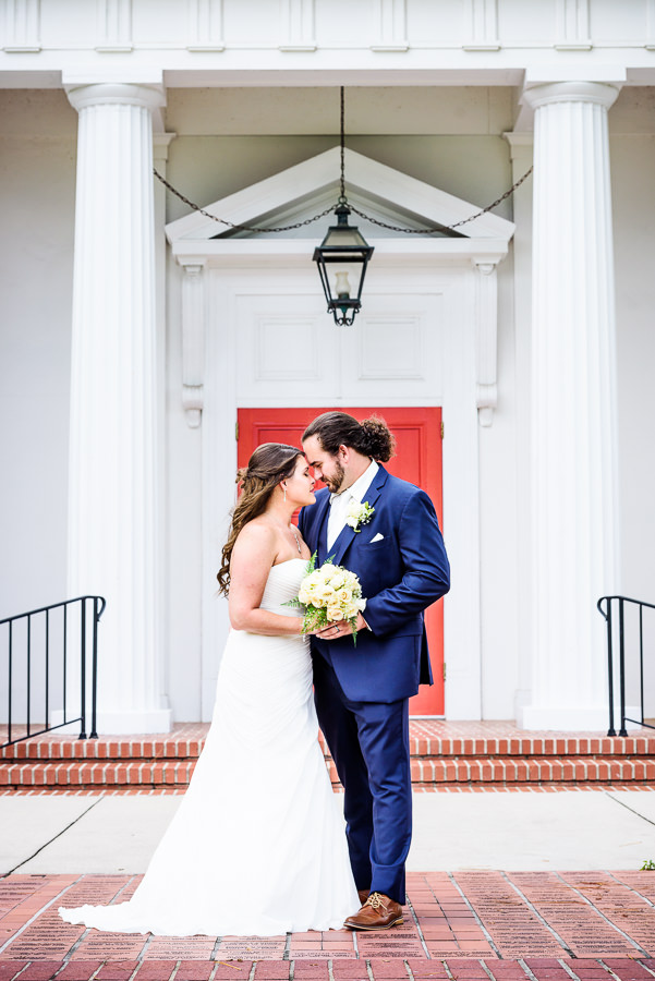 Downtown Pensacola Wedding, Cody and Kerri head to head in front of the church, Lazzat Photography