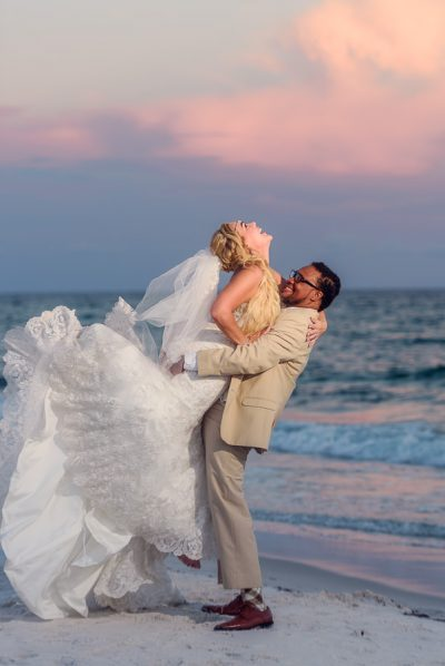 Pensacola Beach Destination Wedding, Delaine picking up Desireé on the beach, Lazzat Photography
