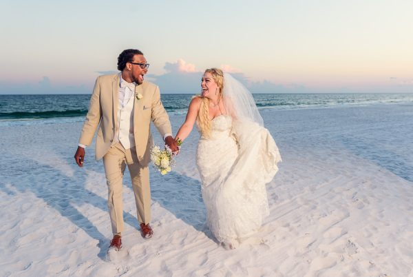 Pensacola Beach Destination Wedding, Desireé and Delaine walking on the beach, Lazzat Photography