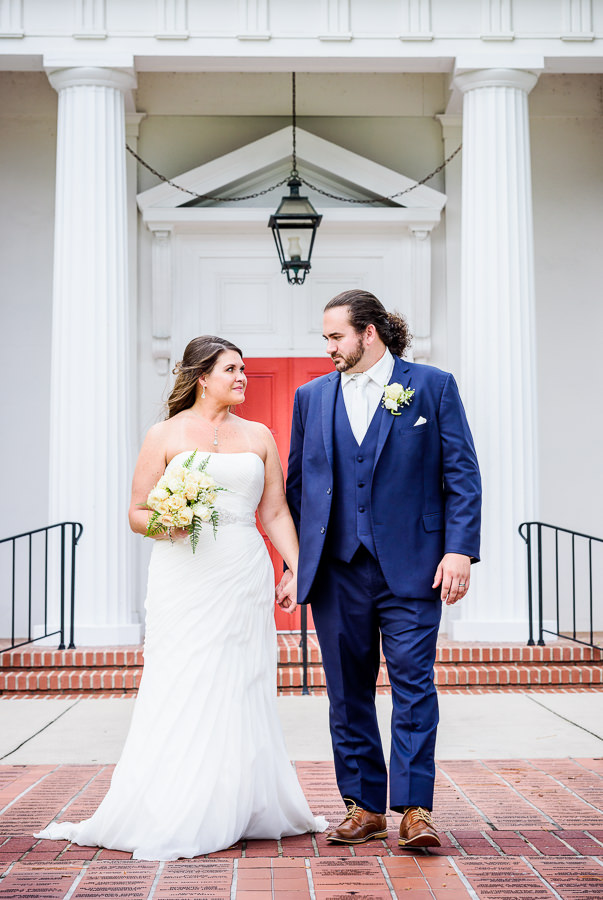 Downtown Pensacola Wedding, Cody and Kerri looking at each other in front of the church, Lazzat Photography