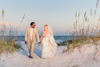 Pensacola Beach Destination Wedding, Desireé and Delaine walking in the dunes, Lazzat Photography