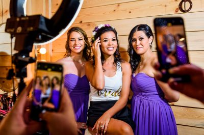Michelle and her Bridesmaids getting their pictures taken on two cellphones, Rustic Barn Wedding, Pensacola wedding photographer, Lazzat Photography
