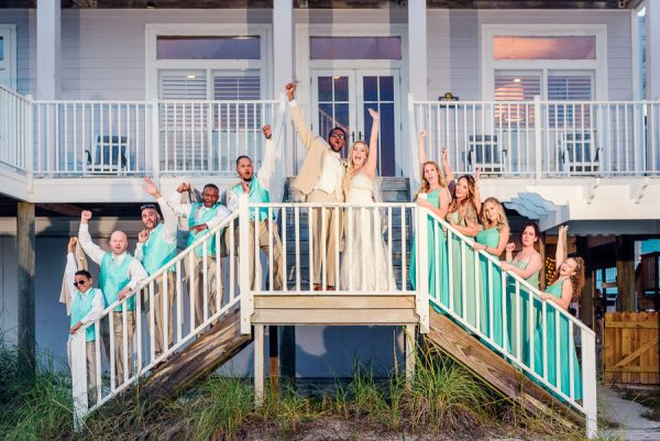Pensacola Beach Destination Wedding, Desireé, Delaine and their wedding party cheering on the stairs, Lazzat Photography