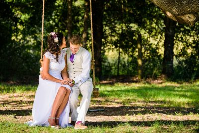 Michelle and Brent laughing on the swing, Ates Ranch Wedding Barn, Rustic Barn Wedding, Pensacola wedding photographer, Lazzat Photography