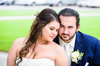 Downtown Pensacola Wedding, close up of Cody looking at the camera and Kerri looking down, Lazzat Photography
