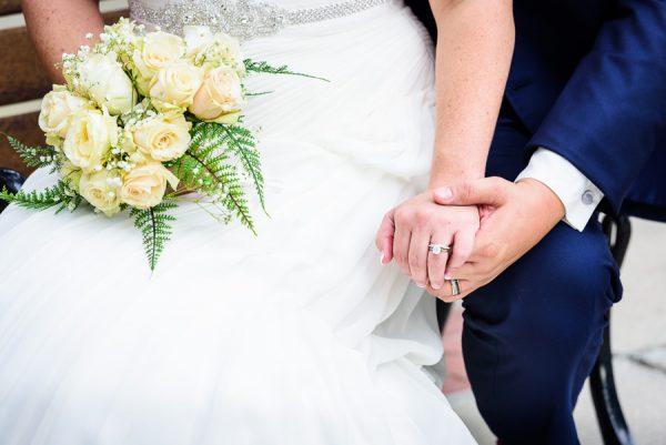 Downtown Pensacola Wedding, close up of Cody holding Kerri's hand, Lazzat Photography
