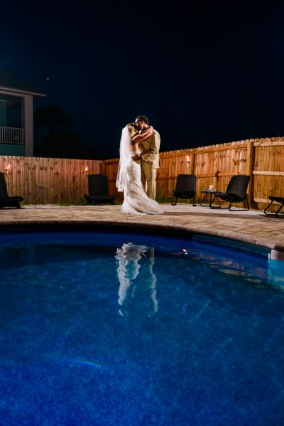 Pensacola Beach Destination Wedding, Desireé and Delaine's first dance from across the pool, Lazzat Photography