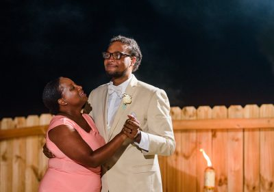 Pensacola Beach Destination Wedding, Desireé dancing with his mother close up, Lazzat Photography