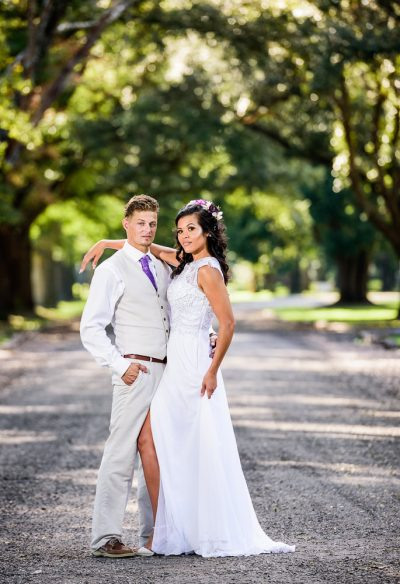 Michelle and Brent looking at the camera on the street, full body, Ates Ranch Wedding Barn, Rustic Barn Wedding, Pensacola wedding photographer, Lazzat Photography