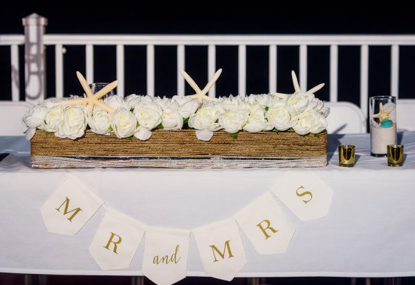 "Pensacola Beach Destination Wedding, Desireé and Delaine's head table with ""Mr and Mrs"" sign, Lazzat Photography"