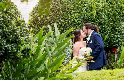 Downtown Pensacola Wedding, Cody and Karri almost kissing in garden, Lazzat Photography