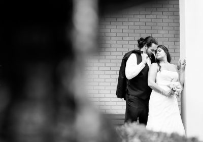 Downtown Pensacola Wedding, Cody and Karri head to head with eyes closed, black and white, Lazzat Photography