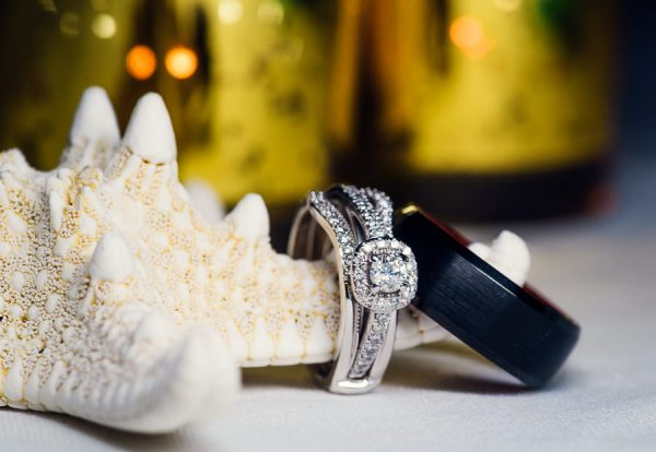 Pensacola Beach Destination Wedding, Desireé and Delaine's wedding rings on starfish, Lazzat Photography