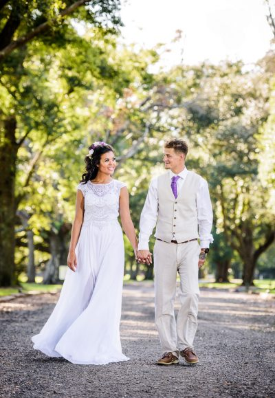 Michelle and Brent looking at each other holding hands, full body, Ates Ranch Wedding Barn, Rustic Barn Wedding, Pensacola wedding photographer, Lazzat Photography