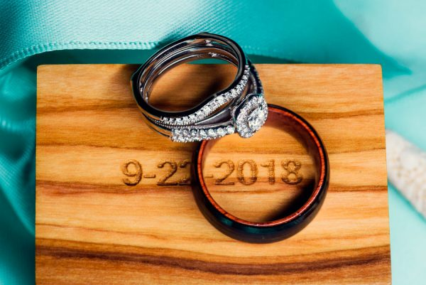"Pensacola Beach Destination Wedding,Desireé and Delaine's wedding rings on top of ""9-22-2018"" box, Lazzat Photography"