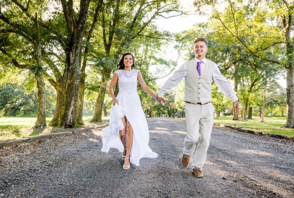 Michelle and Brent running towards the camera, Ates Ranch Wedding Barn, Rustic Barn Wedding, Pensacola wedding photographer, Lazzat Photography